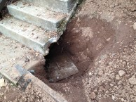 septic lid under stairs
